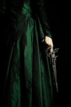 Natasza Fiedotjew hand of young woman in historical dress holding powder pistol