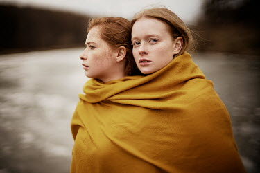 Alexandra Bochkareva TWO GIRLS WRAPPED IN BLANKET BY LAKE Women