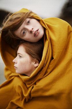 Alexandra Bochkareva TWO GIRLS WRAPPED IN BLANKET OUTDOORS Women