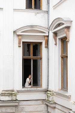 Dorota Gorecka GIRL SITTING IN WINDOW OF GRAND HOUSE Women