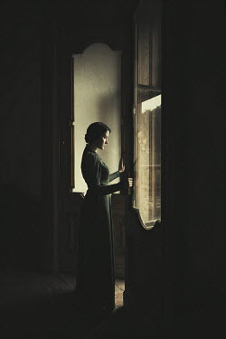 Dorota Gorecka WOMAN OPENING DOORS IN DARK HOUSE Women