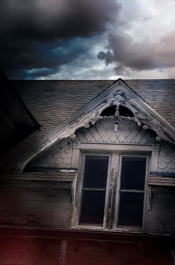 Jill Battaglia WINDOWS AND ROOF OF OLD HOUSE WITH STORMY SKY Houses