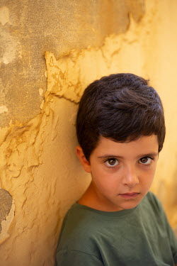 Mohamad Itani SERIOUS LITTLE BOY WITH DARK HAIR OUTDOORS Children