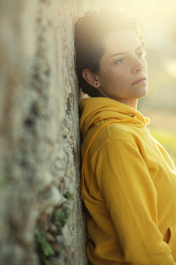 Mohamad Itani WOMAN LEANING AGAINST WALL IN SUNLIGHT OUTDOORS Women