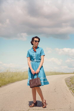 Joanna Czogala GIRL STANDING ON COUNTRY ROAD IN SUMMER Women