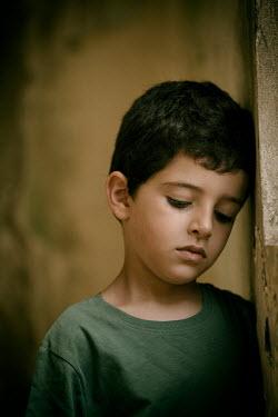 Mohamad Itani SAD LITTLE BOY BY WINDOW IN DERELICT BUILDING Children