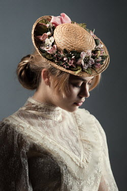 Magdalena Russocka historical woman wearing straw hat and lace dress inside