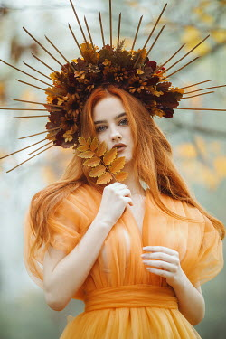 Jovana Rikalo WOMAN WITH RED HAIR AND FLORAL HEADDRESS OUTDOORS Women