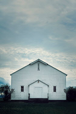 Lisa Bonowicz WHITE WOODEN BUILDING IN COUNTRYSIDE AT DUSK Miscellaneous Buildings
