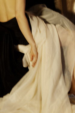 Daria Amaranth Arm of woman and white dress