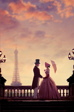 Lee Avison Victorian couple in Paris with eiffel tower at twilight