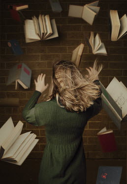 Robin Macmillan Young blonde woman under falling books