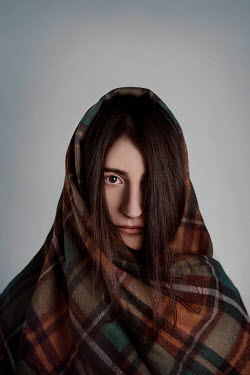 Giada Piras Young woman wrapped in checked blanket
