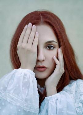Giada Piras Portrait of young woman covering eye