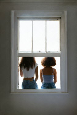 Miguel Sobreira Sisters sitting on window sill