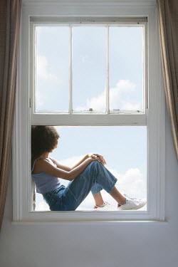 Miguel Sobreira Girl Sitting on Window Sil