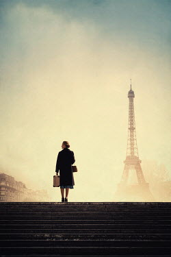 Magdalena Russocka retro woman with suitcase in paris