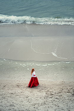 Magdalena Russocka historical woman walking on beach