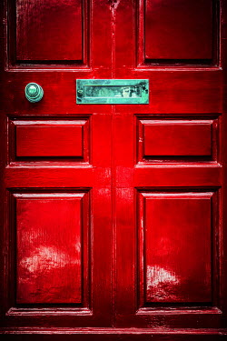 Magdalena Russocka close up of red door with knob and letter box