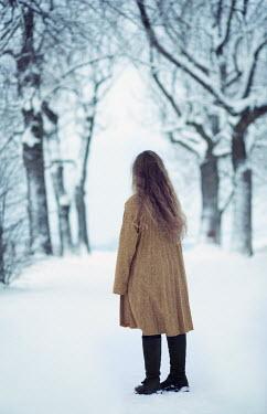 Carmen Spitznagel BLONDE WOMAN WALKING IN SNOWY COUNTRYSIDE Women