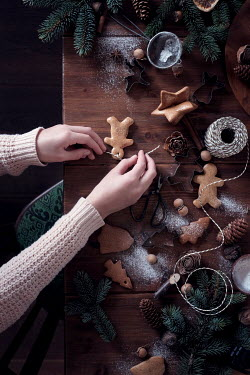 Galya Ivanova WOMAN MAKING BISCUIT DECORATIONS FOR CHRISTMAS TREE Women