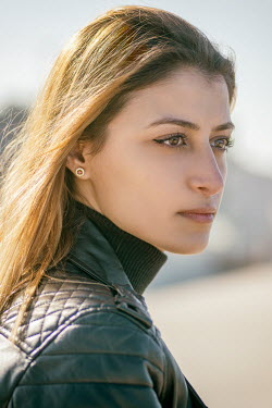 Mohamad Itani SERIOUS WOMAN IN LEATHER JACKET OUTDOORS Women