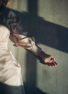 Mark Owen WOMAN IN DRESS LYING ON FLOOR WITH SHADOW Women