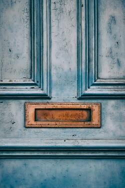 Tim Robinson Mail slot on weathered blue door