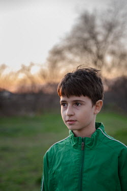 Galya Ivanova Boy in green jacket at sunset