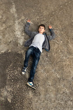 Galya Ivanova Boy lying on concrete