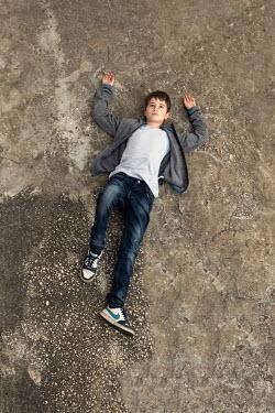 Galya Ivanova Boy lying on concrete