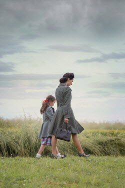 Joanna Czogala Mother and daughter walking in field