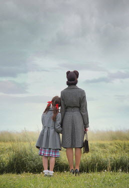 Joanna Czogala Mother and daughter standing in field