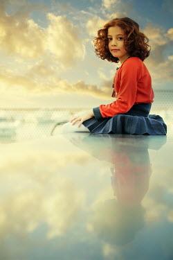 Mohamad Itani Girl sitting on bench at sunset