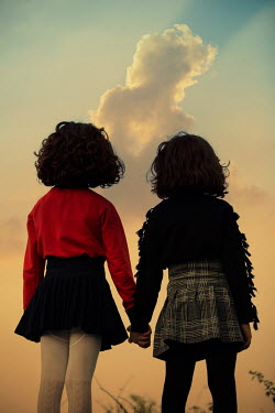 Mohamad Itani Girls holding hands at sunset