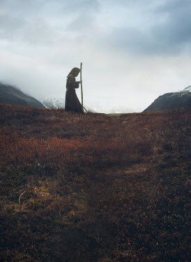 Mark Owen Monk with stick in field