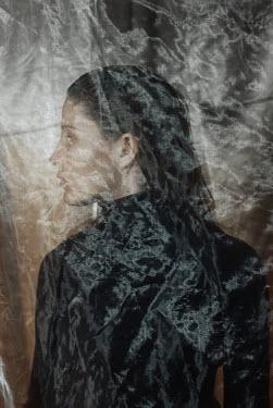 Daria Amaranth Young woman behind sheer fabric