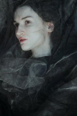Daria Amaranth Young woman under sheer fabric