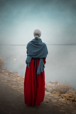 Ildiko Neer Old historical woman standing by lake