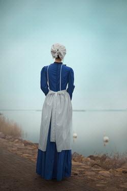 Ildiko Neer Amish woman standing by lake