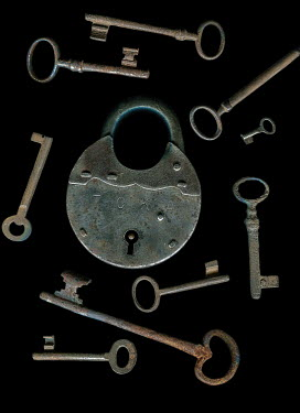 Magdalena Wasiczek Padlock and scattered keys on black background