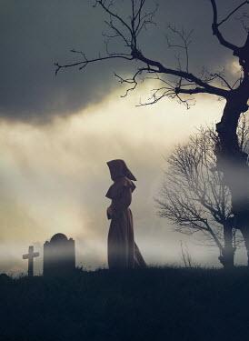 Mark Owen Monk with brown robes in graveyard