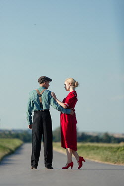 Magdalena Russocka retro couple embracing on country road