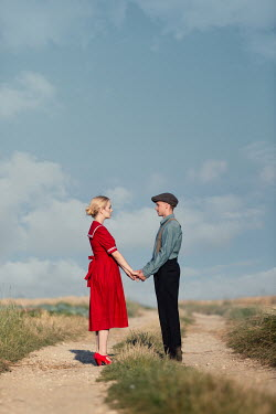 Magdalena Russocka retro couple standing on country road