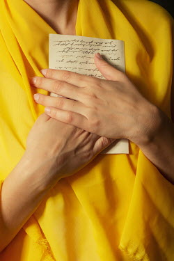 Mohamad Itani Hands of young woman holding letter