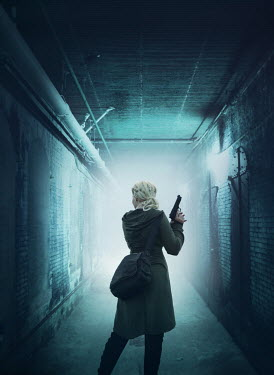 Mark Owen Young woman with pistol in tunnel