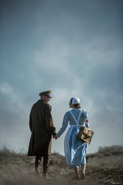 Magdalena Russocka wartime soldier and nurse walking in field