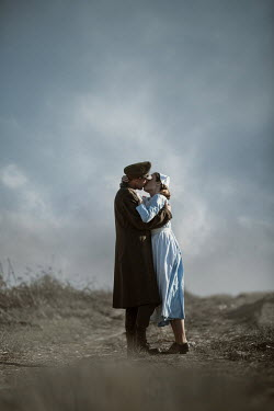 Magdalena Russocka wartime soldier and nurse kissing in field