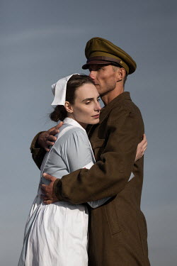 Magdalena Russocka wartime soldier and nurse embracing in field