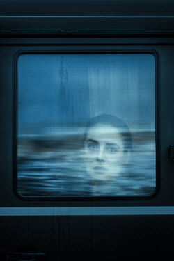 Magdalena Russocka Young woman in window of bus